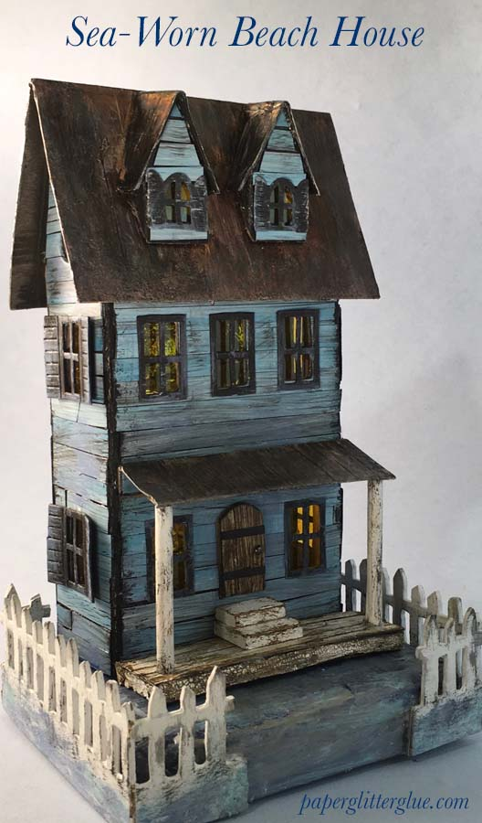 Sea-worn beach house cardboard house