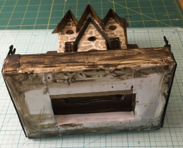 Stone house with cardboard base to allow LED lighting