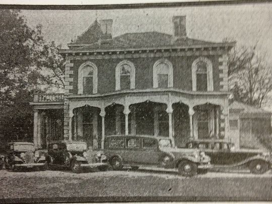 Old photo of side of the Wilkins Houses