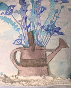 Tim Holtz Watering Can to anchor the flowers on the Frosted Butterflies Mixed Media project