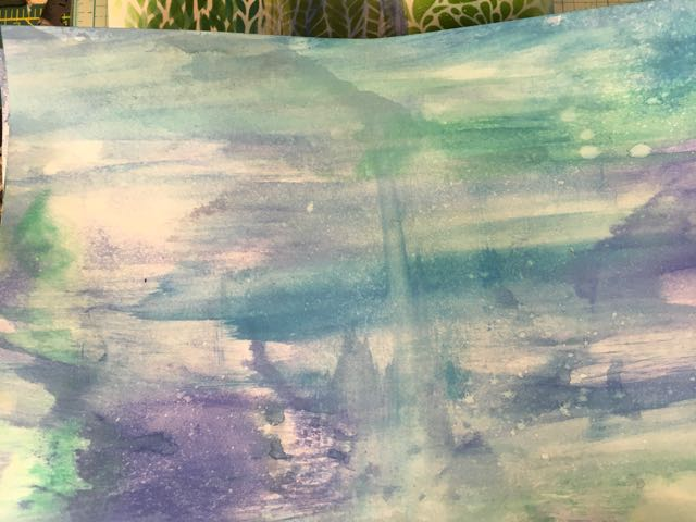 Watercolor paper covered with distress oxide inks