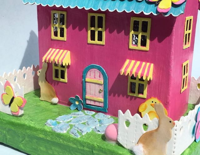 Front view of pastel Easter house closeup