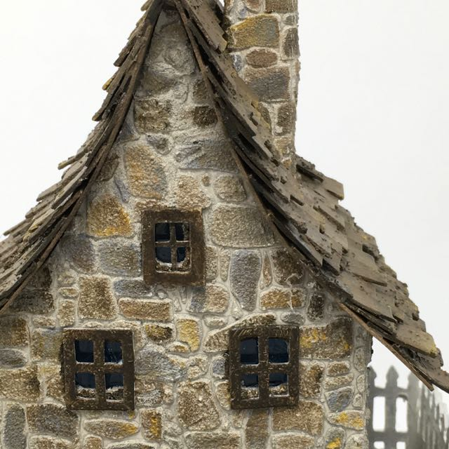 Close-up of stone texture on Irish cottage which mimics the look of real stone