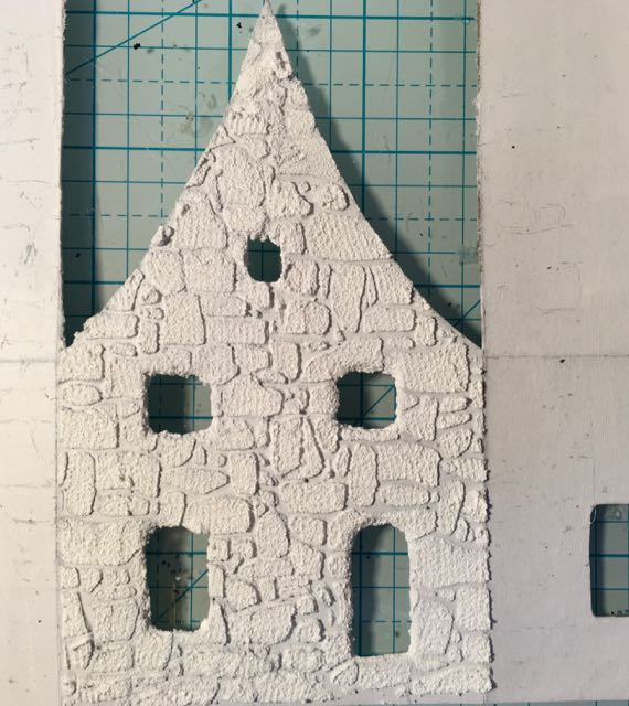 Texture paste stenciled on cardboard house pattern - make a stone texture on paper craft