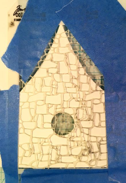 Stone stencil taped to cardboard house #paperhouse #papercraft #stonetexture