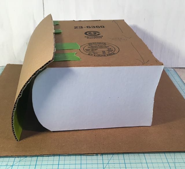 Book box side view with curved cardboard spine