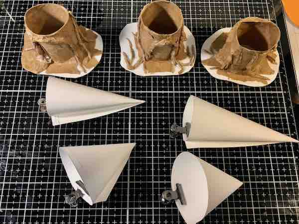 3 more Halloween tree stump paper houses in progress with cones