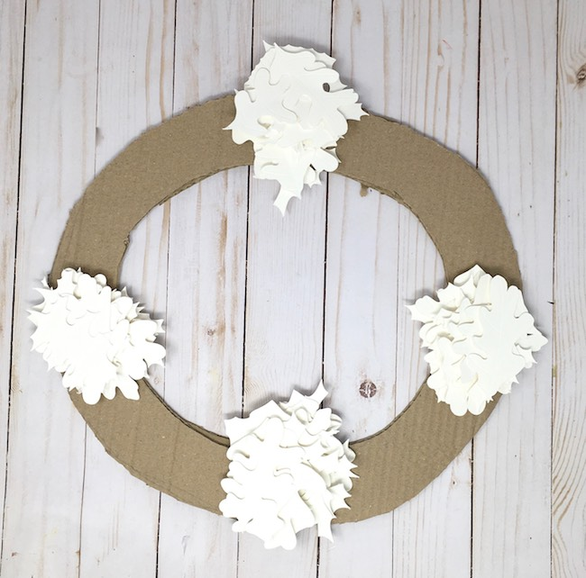 4 piles of paper leaves for fall leaf wreath