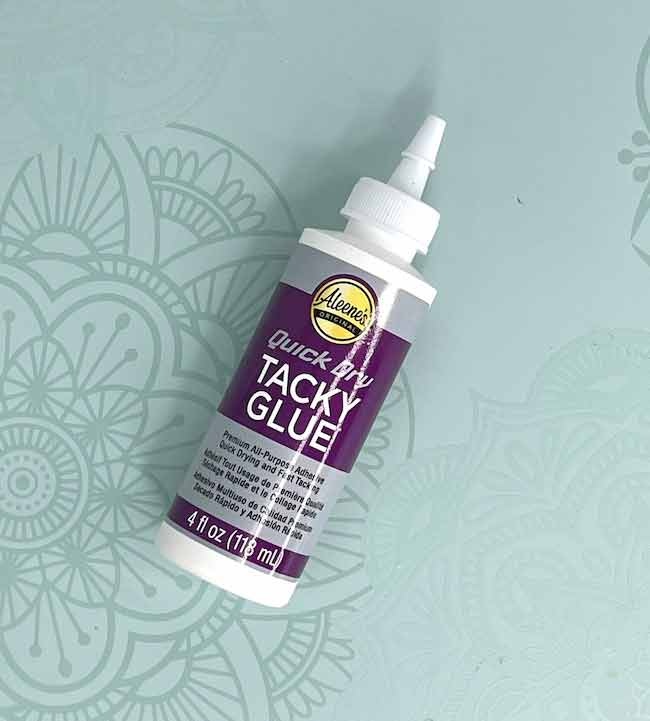 Aleene's Quick Dry Tacky Glue used for making paper houses