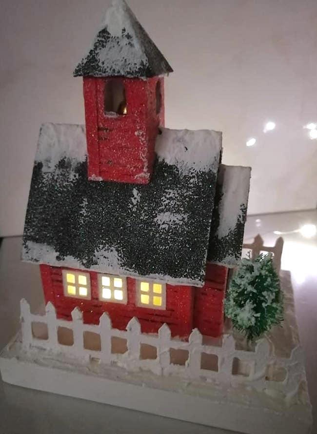 Alta snowy schoolhouse with lights on