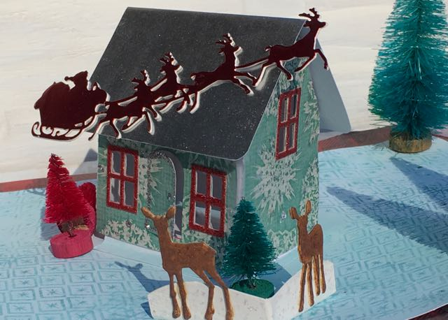Altered village dwelling house as a pop up Christmas card