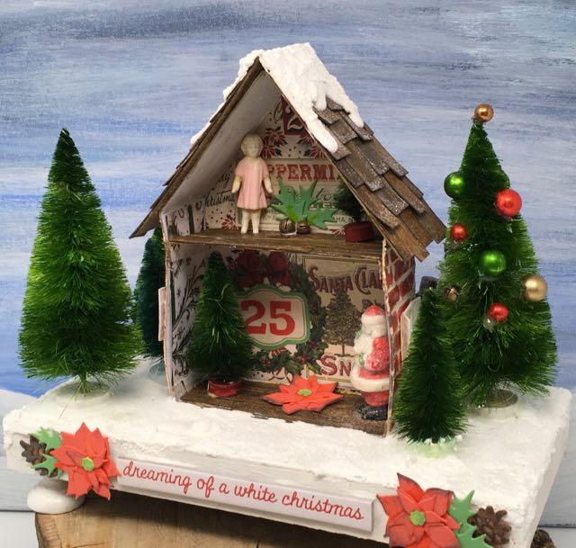 Angle view Christmas miniature house shadow box