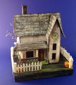 Jennifer's paper Halloween House with pumpkins in yard and spooky cardboard fence