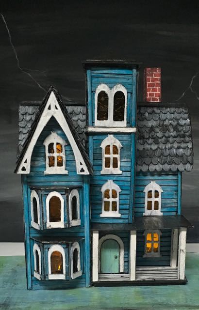 Another view of the miniature Faded Mansion with lights on