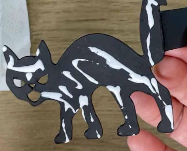 Apply glue to add extra cardboarrd cat