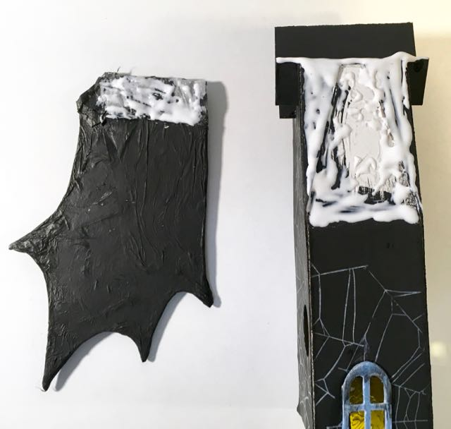 Apply glue to bat wing Halloween House