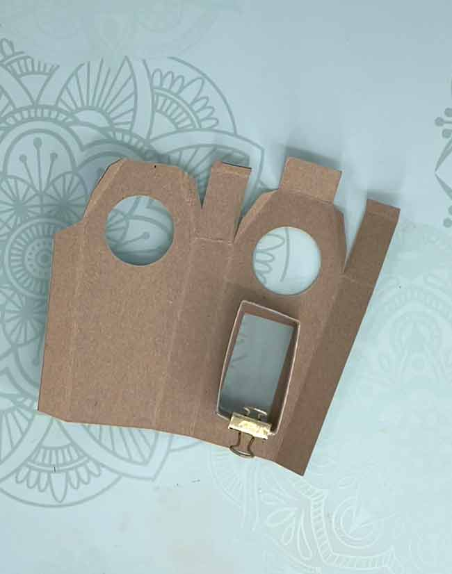 Back of miniature coffin clock showing support strip for pendulum