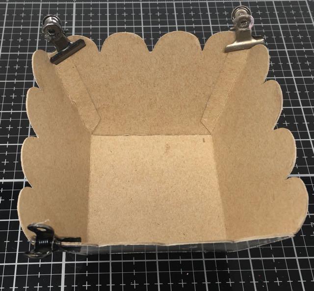 Binder clips holding flaps Valentine candy basket