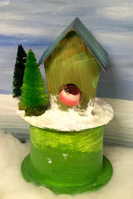Miniature bird house with fat little bird
