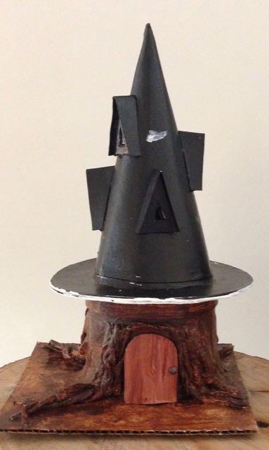 Black Hat Inn on the tree stump base