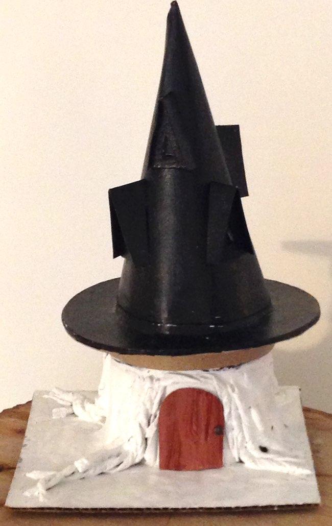 Black Hat on primed tree stump base for Black Hat Inn