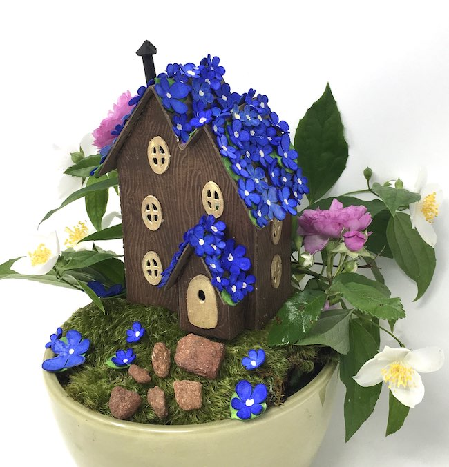 Blue blossom fairy house on mossy base