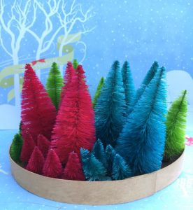 Bottle brush trees stained with distress spray stains#bottlebrushtree #christmasornaments #putzhouse