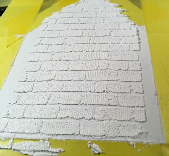 Brick texture on christmas house shadow box