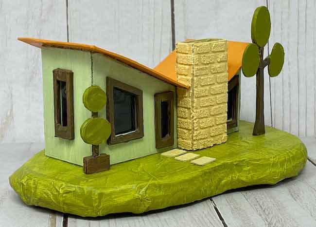 Green Mid-Century Modern Putz House with retro trees and a yellow chimney in front
