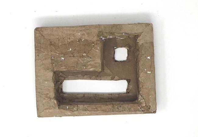 Cardboard base before priming