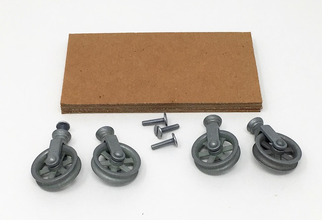 Cardboard base with mini pulley wheels and longer screws