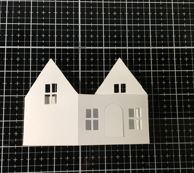 Folded die cut of Tim Holtz Village Dwelling for pop-up house #timholtz #sizzix #villagedwelling #popupcard