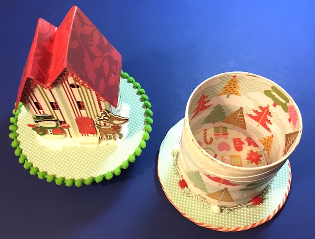 Christmas Putz house as a gift box on ribbon roll base
