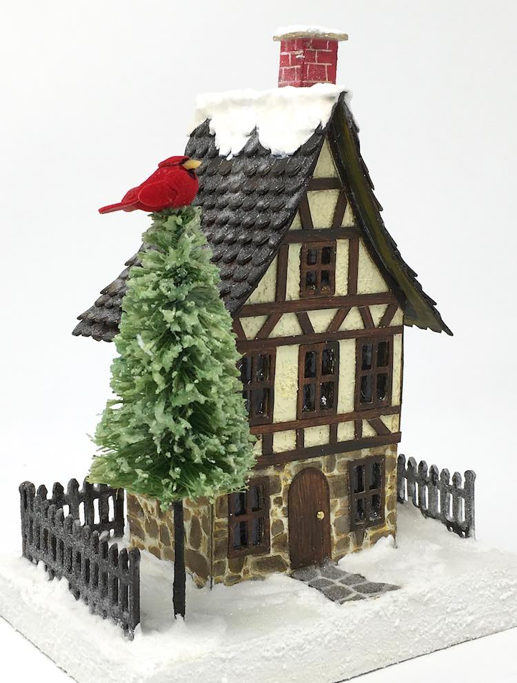 Christmas Village house with a custom bottlebrush tree with cardinal on top