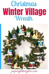 Christmas Winter Village wreath with snow-covered putz houses