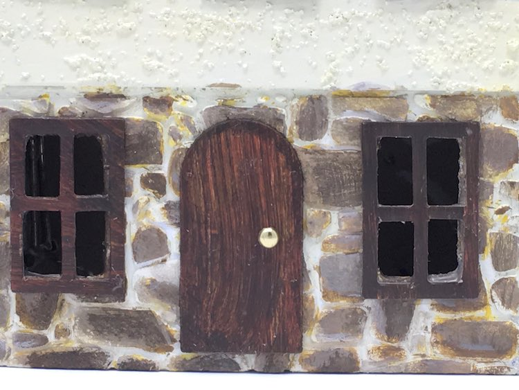 Close-up door and windows on Christmas village house