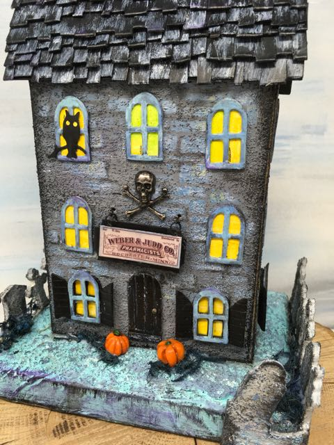 Front of the Apothecary Halloween house with Apothecary cabinet in the back - miniature Halloween potions shop