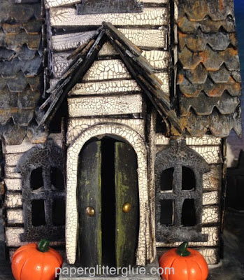 Halloween village dwelling Close-up of Village Manor miniature cardboard house