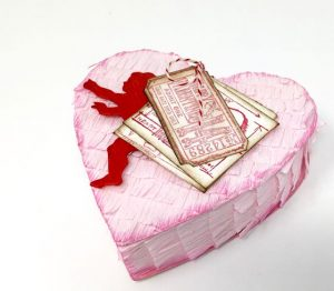 Heart-shaped Valentine Piñata candy box with Cupid and Valentine tickets