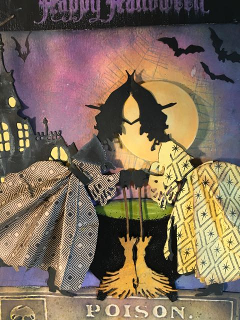 Two Witches made with Tim Holtz Witchcraft die, cut like paper dolls attached at the hat and the brooms #halloween #papercraft