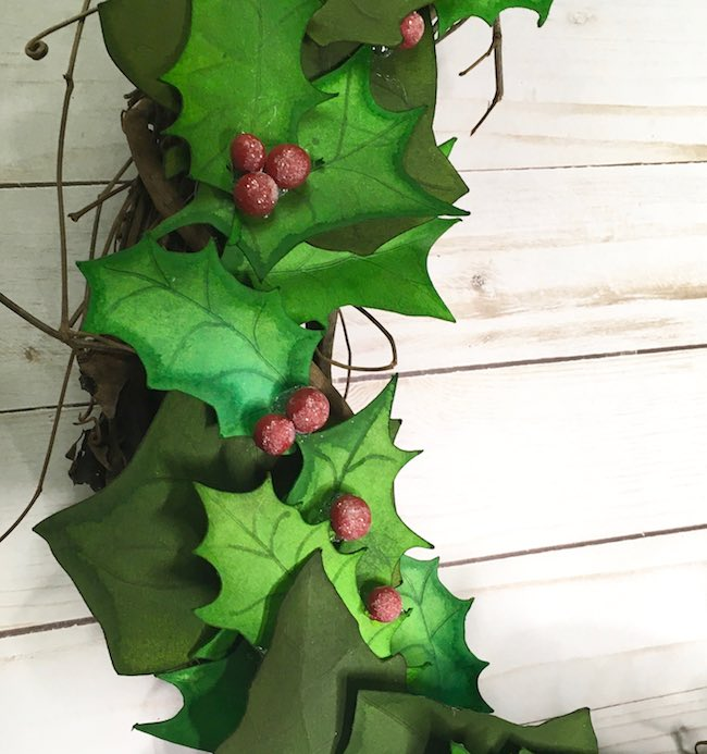 Close up of wreath paper leaves and berries