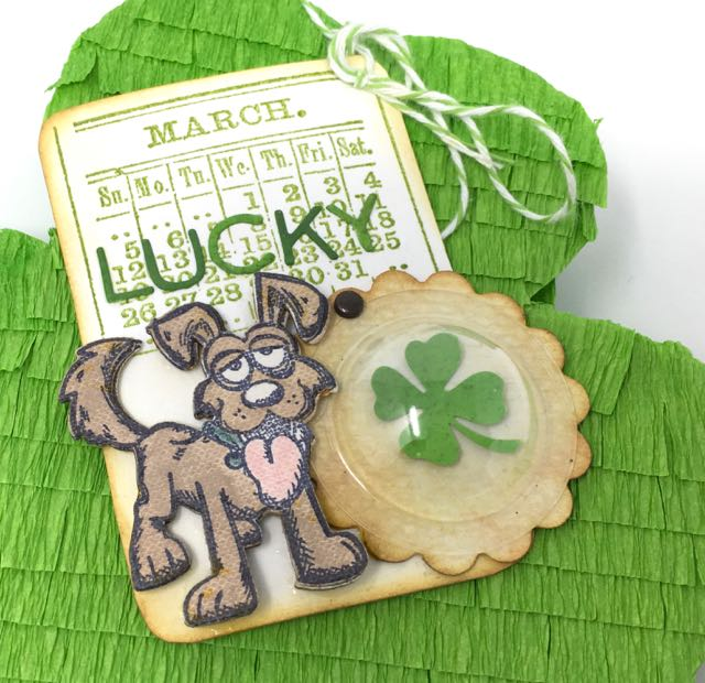 Close-up of Shamrock Candy Box tag with calendar, lucky word, smiling crazy dog and a four-leaf clover