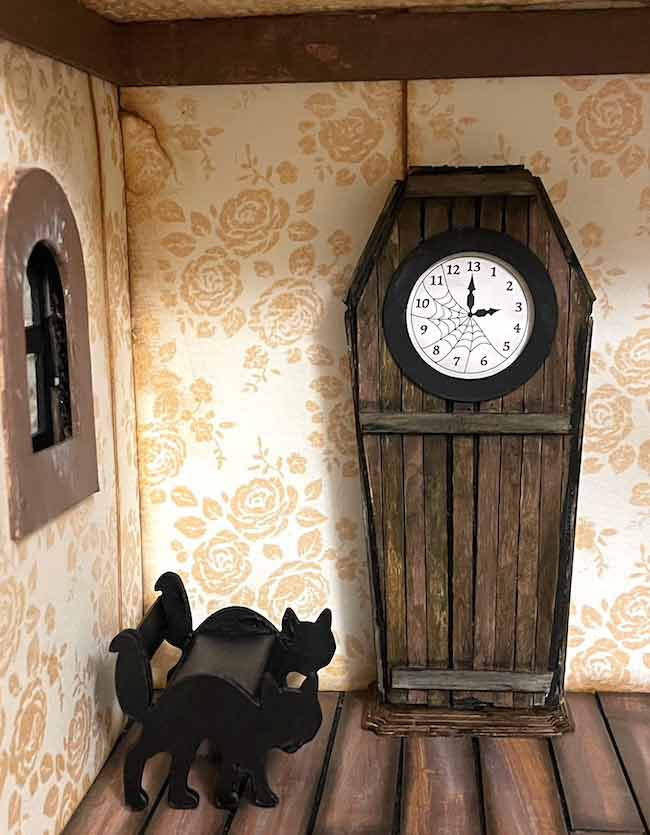 Miniature Haunted clock made with coffee stirrerrs in spooky house