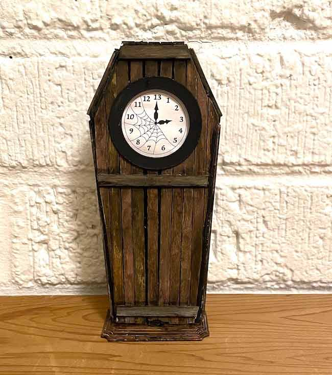 Coffin Haunted Clock made with coffee stirrers as wood surface