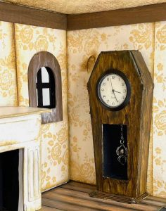 Coffin clock with hanging spider charm