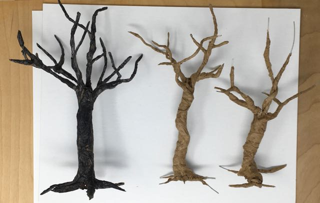 Completed twisted tree designed for Halloween decor with 2 in progress