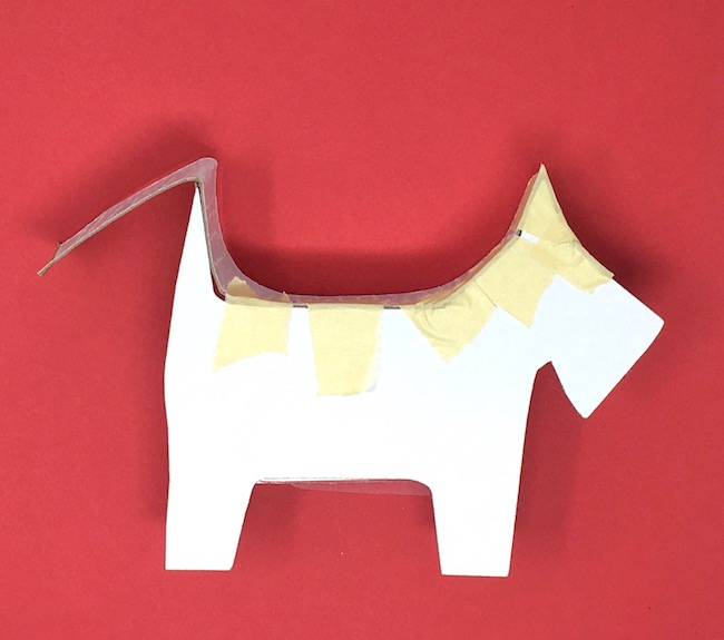 Continue taping cardboard around dog shape