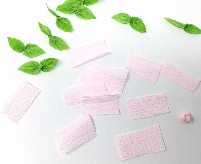 Cut crepe paper for flowers on cherry blossom tree