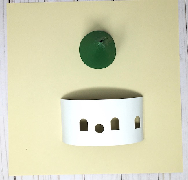 Curved base of cardboard fairy house with cone