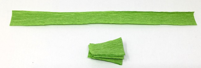 Cut crepe paper strips for leaves on easy cherry blossom tree